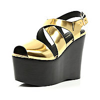 Gold cross strap extreme flatform sandals