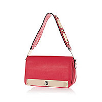 Bright pink metal trim underarm bag