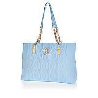 Light blue quilted chain strap tote bag