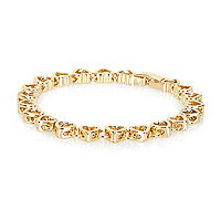 Gold tone repeat heart bracelet
