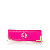 Bright pink slim clutch bag