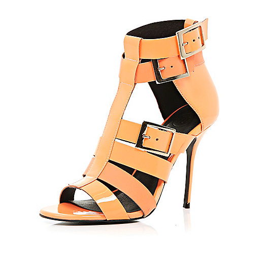 Light orange patent gladiator stilettos