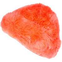 Bright pink faux fur beanie hat