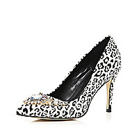 White zebra print embellished court shoes