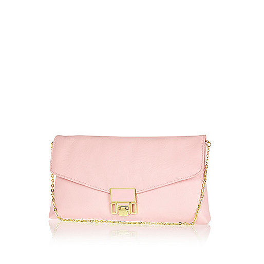 Light pink flip lock clutch bag