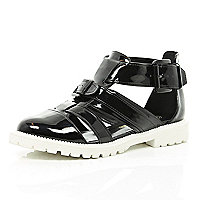 Black patent cut out cleated sole shoes