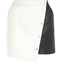 Cream colourblock leather popper mini skirt