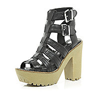 Black cleated sole gladiator platforms