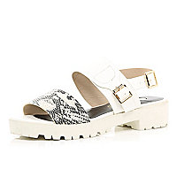 White cleated sole snake strap sandals