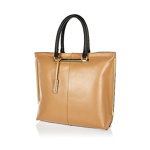 Light brown leather metal trim tote bag