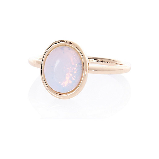 White semi-precious single stone ring