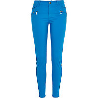 Bright blue skinny biker trousers