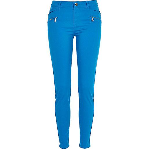 Bright blue skinny biker trousers