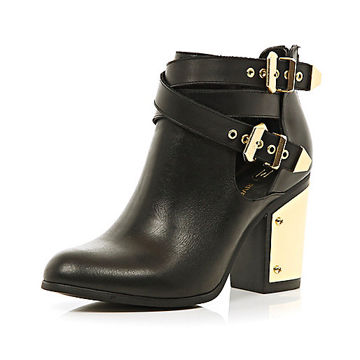 Black cut out metal plate block heel boots