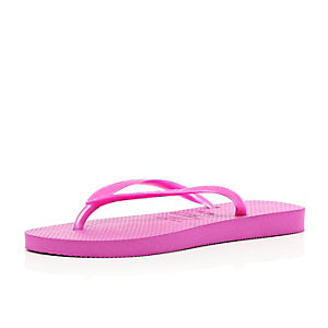 Bright pink slim Havaianas flip flops