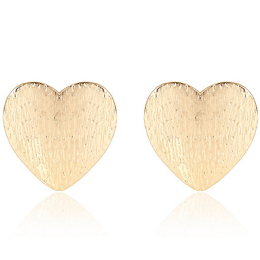Gold tone large heart stud earrings