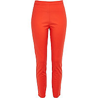Orange skinny ankle grazer trousers