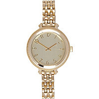 Gold tone oversized face bracelet watch