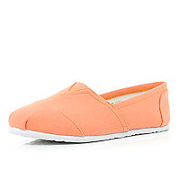 Coral canvas slip on plimsolls