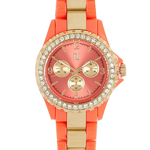 Coral and gold tone metal bracelet watch