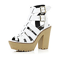 White cleated sole gladiator platforms
