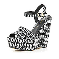 Black geometric print peep toe wedges