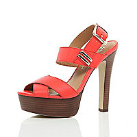 Bright orange strappy platform sandals
