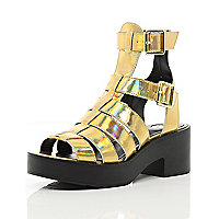 Gold chunky high leg gladiator sandals