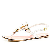 White jewel embellished t bar sandals