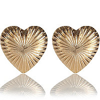 Gold tone heart stud earrings