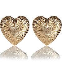Gold tone heart stud earrings