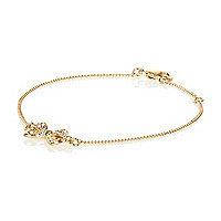 Gold tone diamante bow bracelet