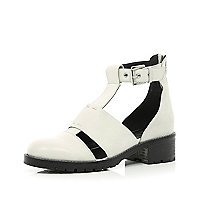 White cut out cleated sole ankle boots