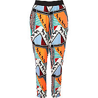 Orange Pacha abstract print trousers