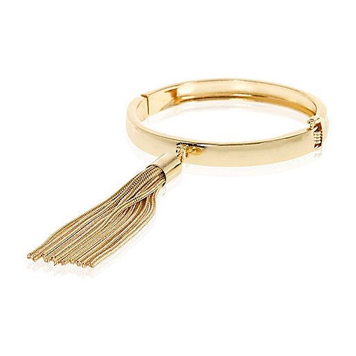 Gold tone chain tassel bangle
