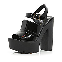 Black patent cleated sole platform sandals