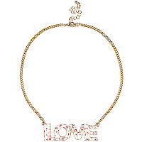 Gold tone floral love necklace