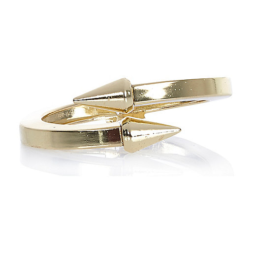 Gold tone spike clamp bangle