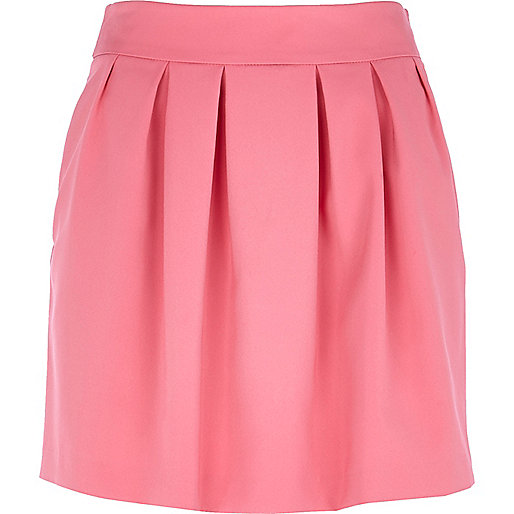 Pink box pleat mini skirt