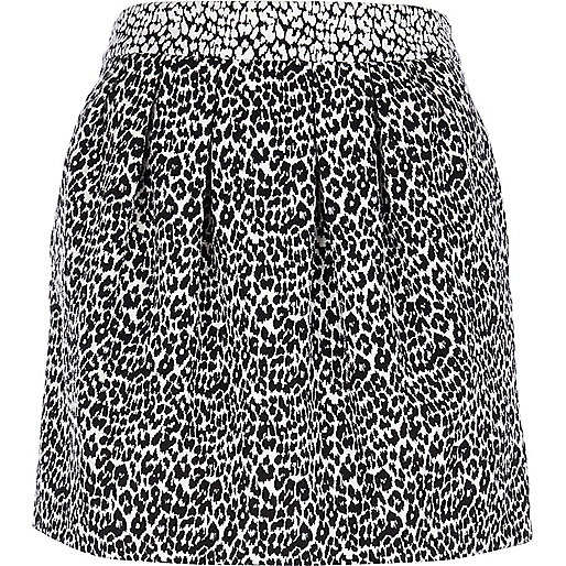 Black and white animal print mini skirt