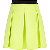 Lime box pleat full mini skirt