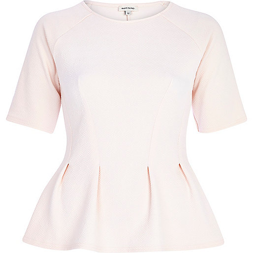 Light pink textured half sleeve peplum top