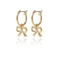 Gold tone bow hoop earrings