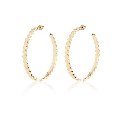 Gold tone repeat heart hoop earrings