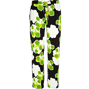 Green floral print slouch trousers
