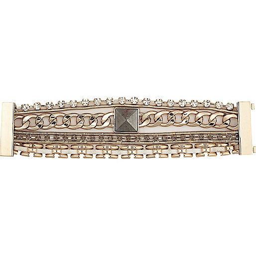 Gold tone eclectic gateway bracelet