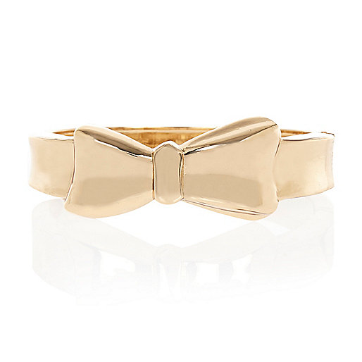 Gold tone bow clamp bracelet