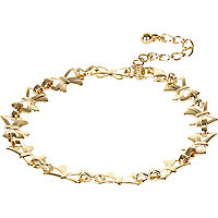 Gold tone repeat bow bracelet