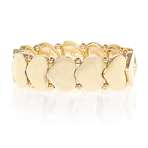 Gold tone repeat heart stretch bracelet