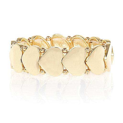 Gold tone repeat heart stretch bracelet
